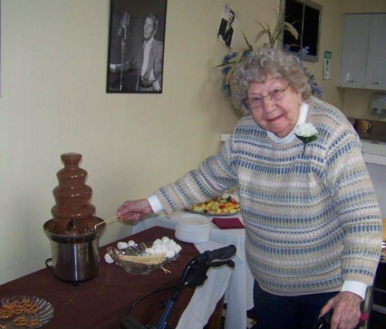 Old lady tasting chocolate