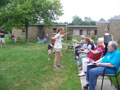 Kids enjoying with the senior people