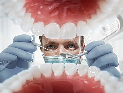 Dentist creating mouth guard for patient in Launceston