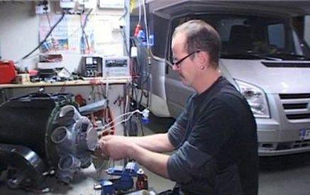 A mechanic making caravan repairs in North Island