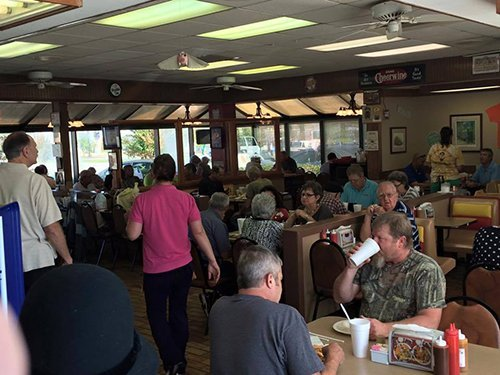 People enjoying food at Carter brothers BBQ restaurant in High Point, NC