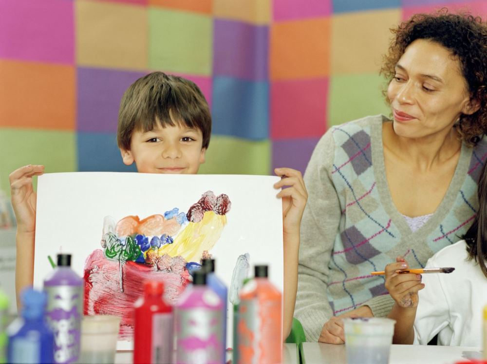 A mom and son do activities at a daycare in Mendon, NY