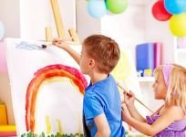 Kids painting during daycare in Mendon, NY
