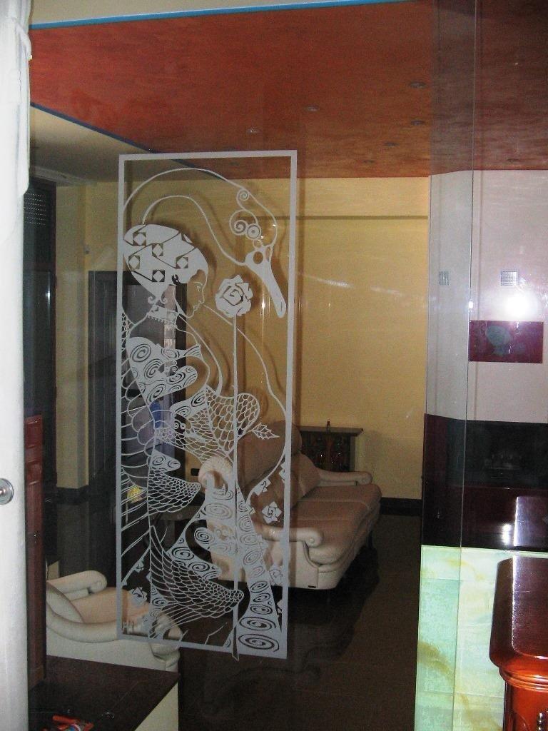 specchi con decorazioni
