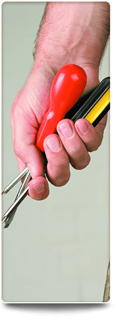 Man's hand holding a spanner