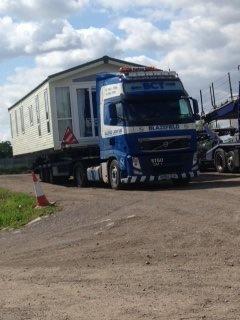 Blue and white caravan