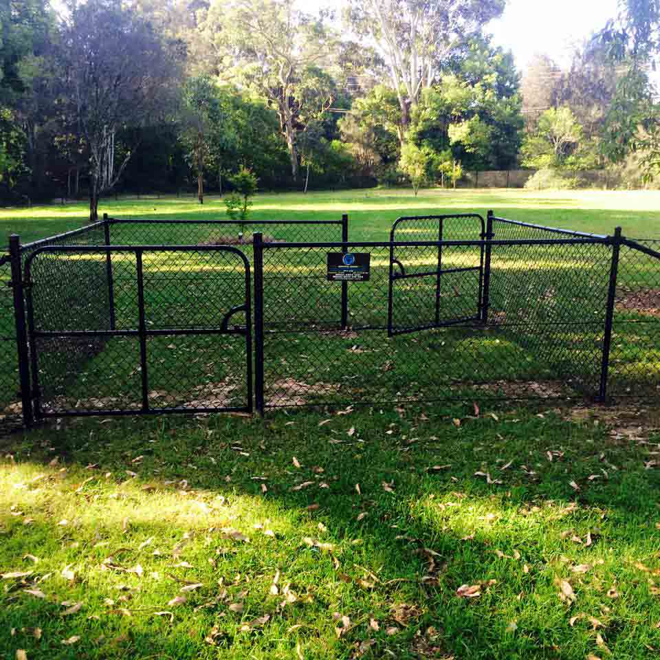 black fencing in the grass