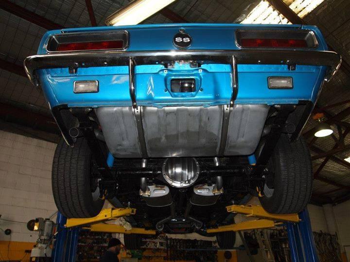 blue car on lift