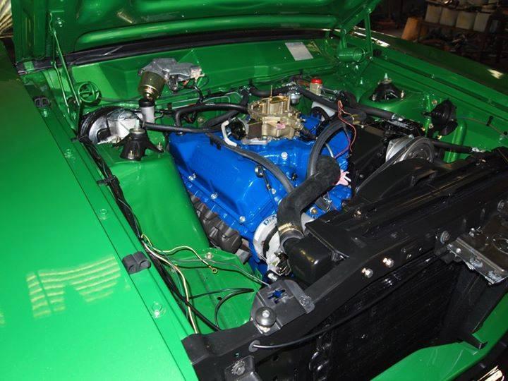 custom engine inside green car