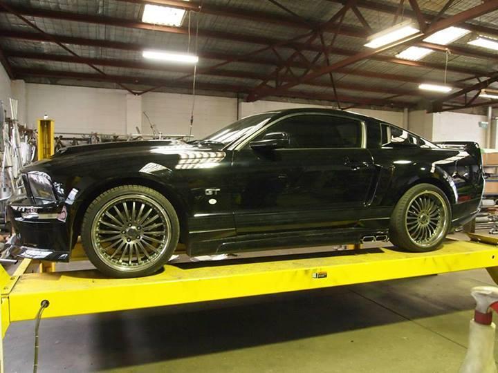 black car on lift