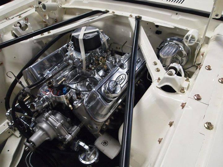 custom engine inside white car