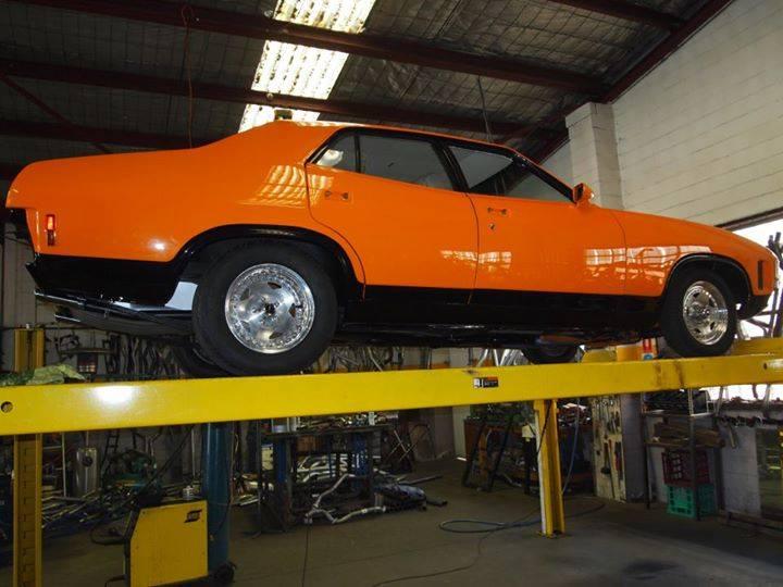 orange car on lift