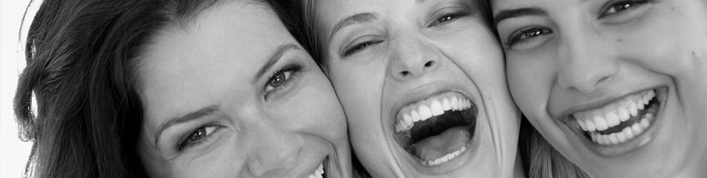Smiling women after Cosmetic dentistry services in Maddington