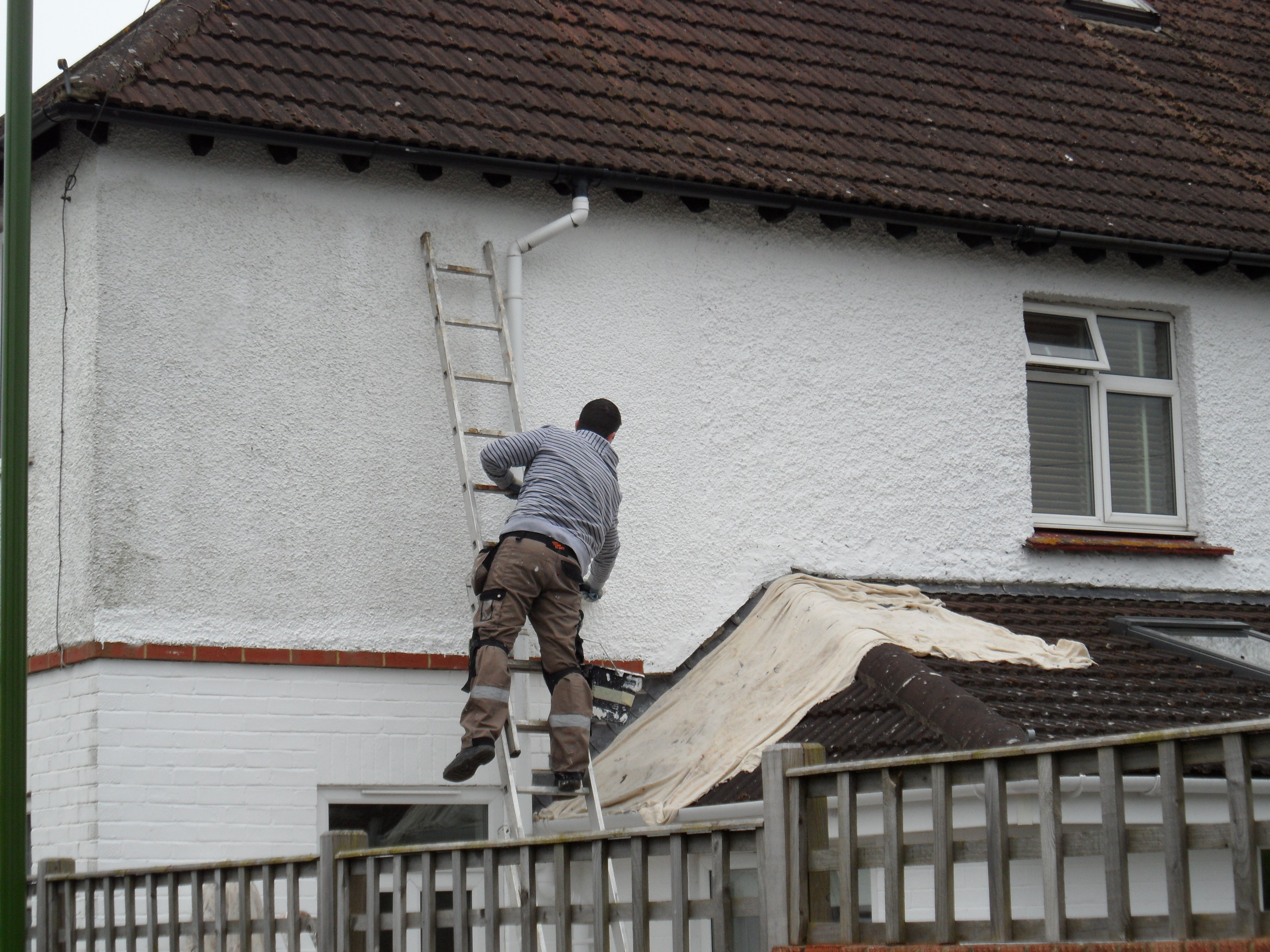exterior wall being painted