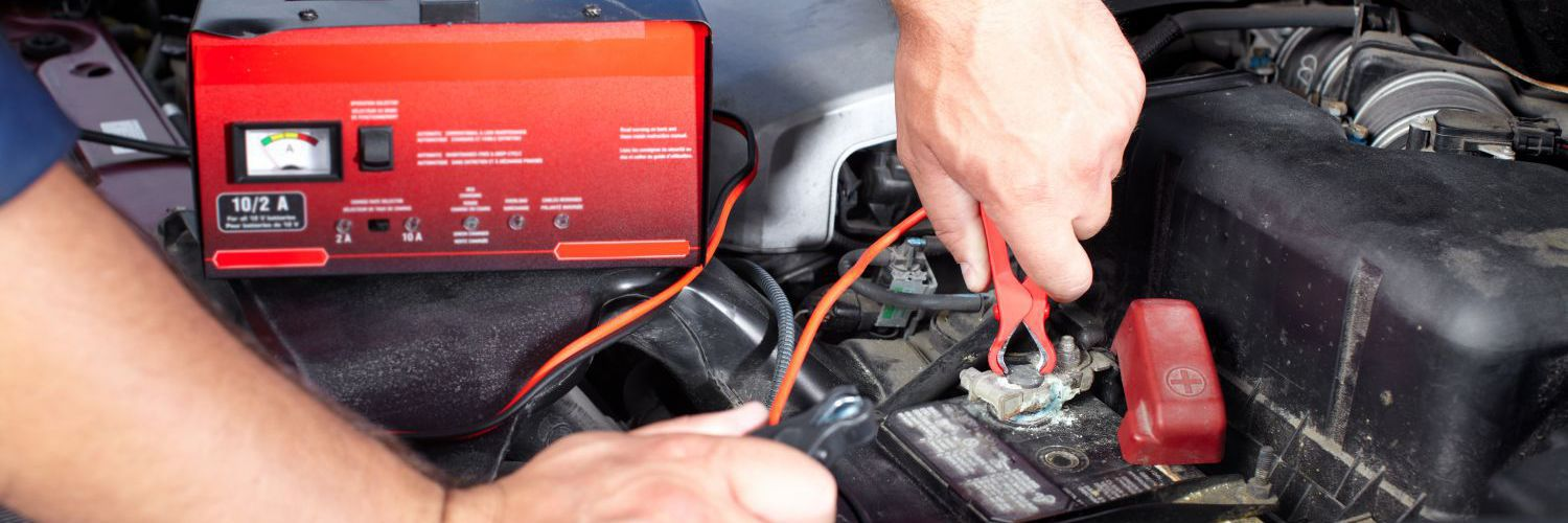 An auto electrician working on a battery in Wellington