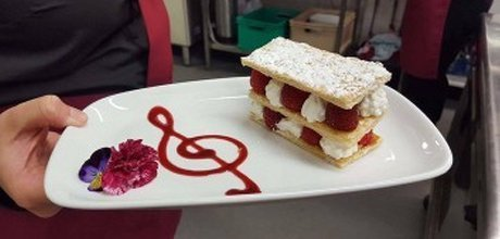 dessert served with a music note pattern