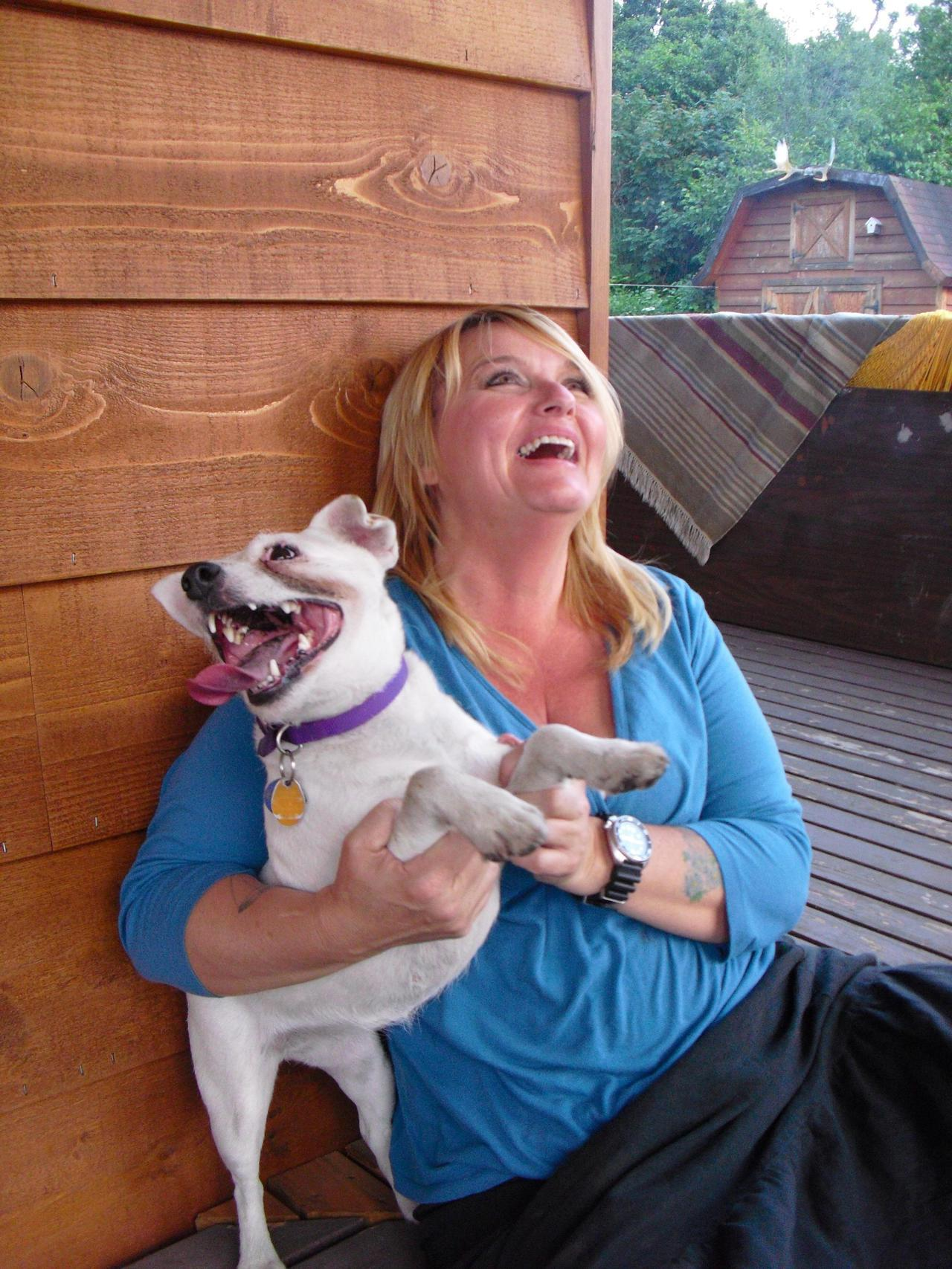 woman sitting with her happy dog