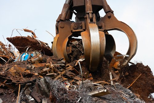 Scrap metal being lifted for recycling in Nekoosa, WI