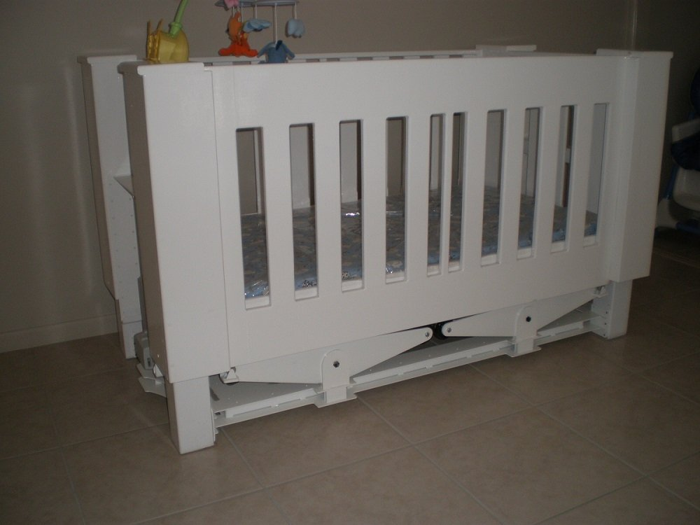 View of a baby cot in white color