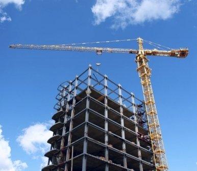 costruzione palazzi, gru, movimento terra