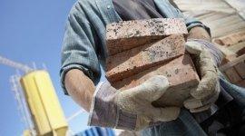 mattoni, cemento, opere edili