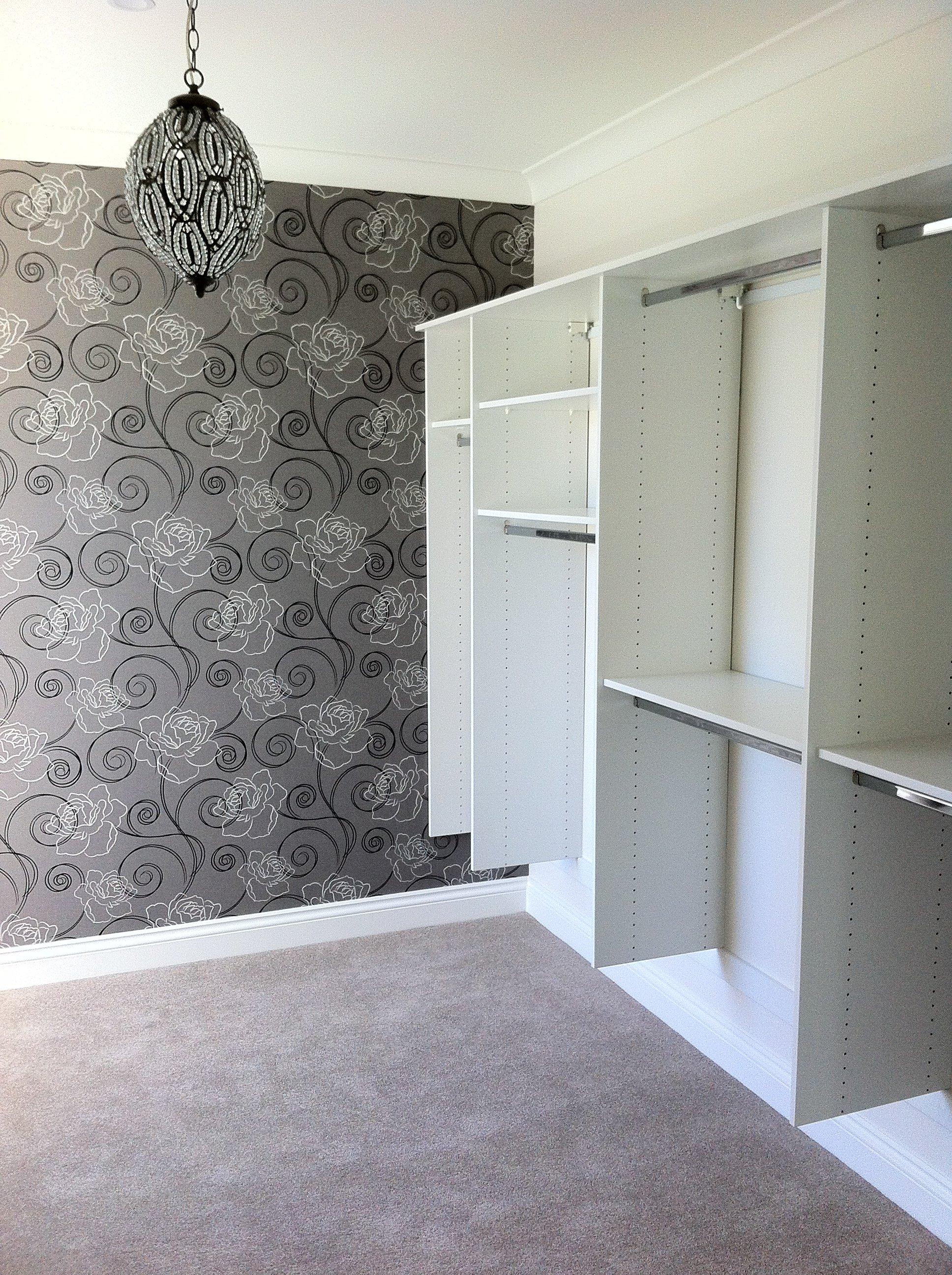 Wallpaper in walk in wardrobe