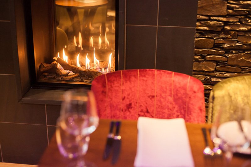 Cosy dining by the fire