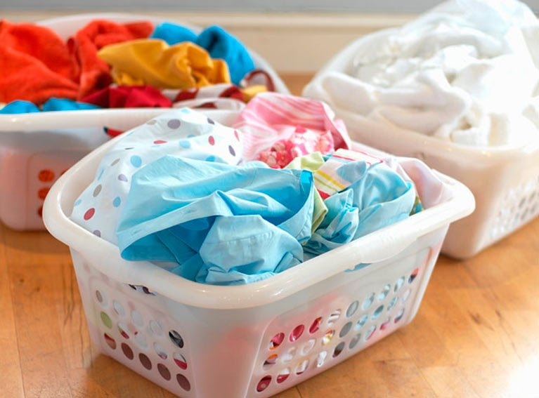 Washing in baskets on floor