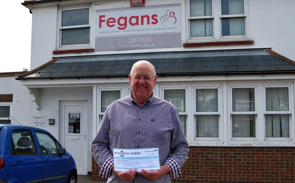 Jim delivers a £300 cheque to Fegans