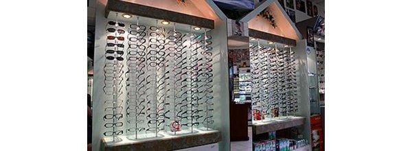 elegance eyewear specs shop interior glasses wooden shelves