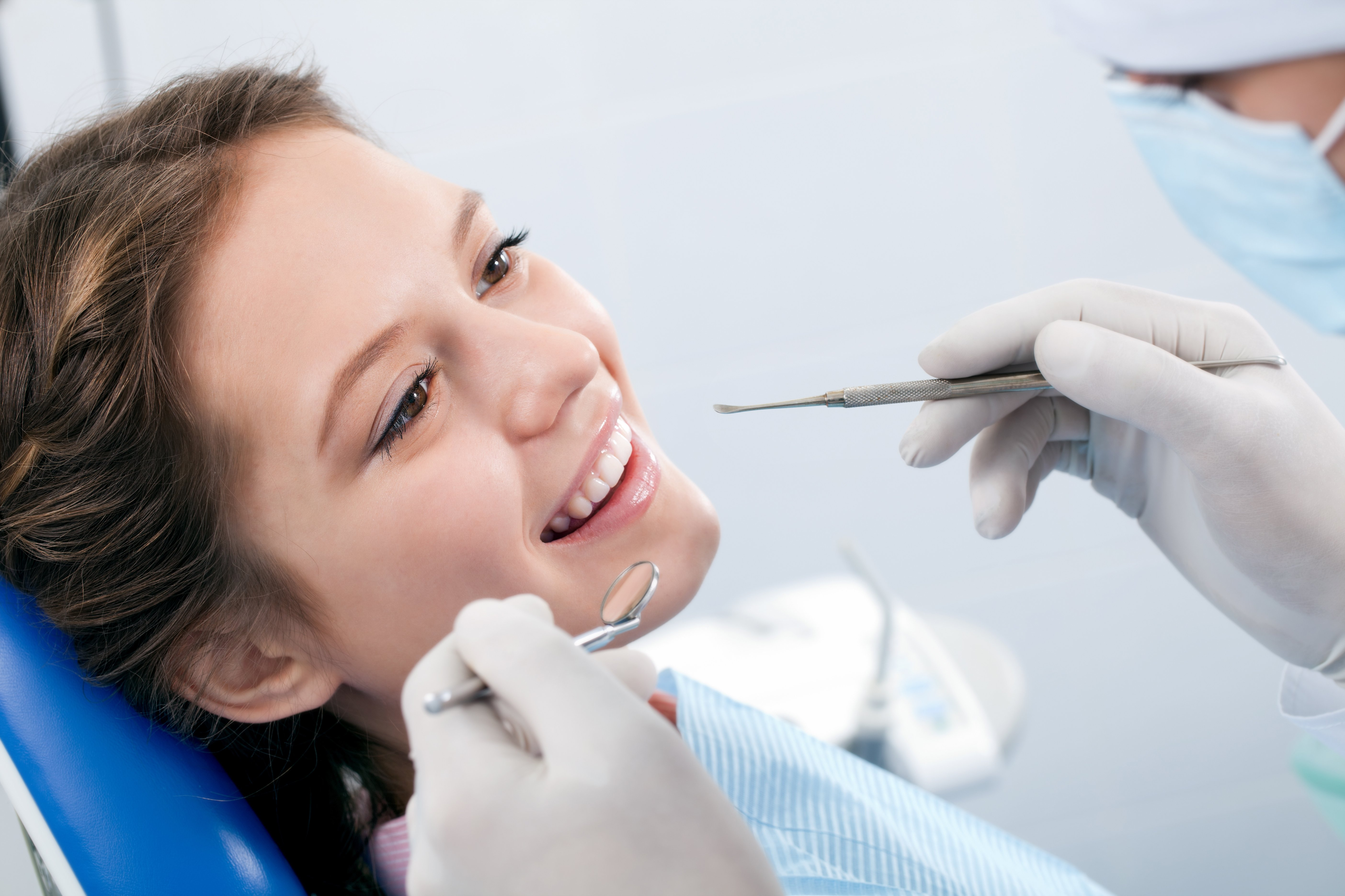 Dentist performing a standard check-up in Cookeville