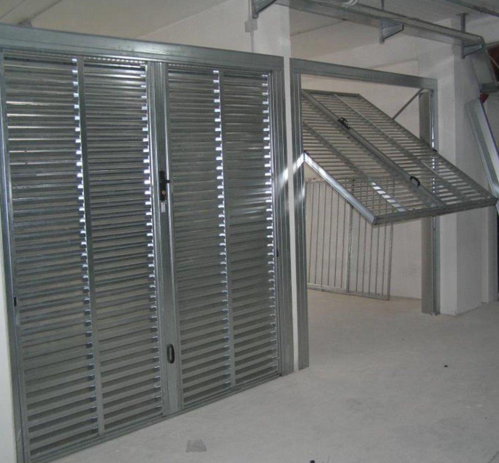 Produzione porte basculanti roma osma - Serratura porta basculante garage ...