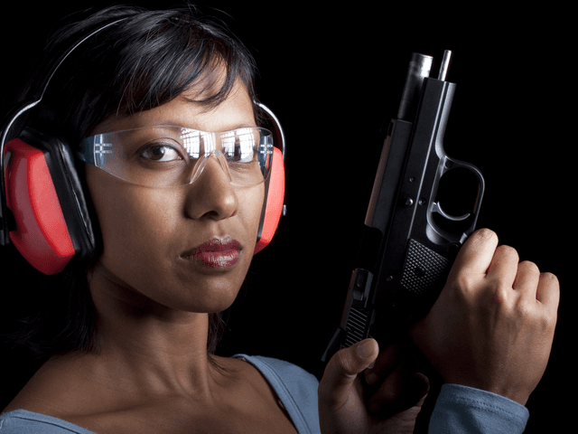 Woman taking the NRA Basic Pistol Course