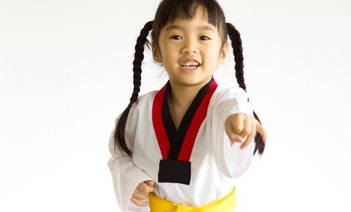 Young girl practicing taekwondo