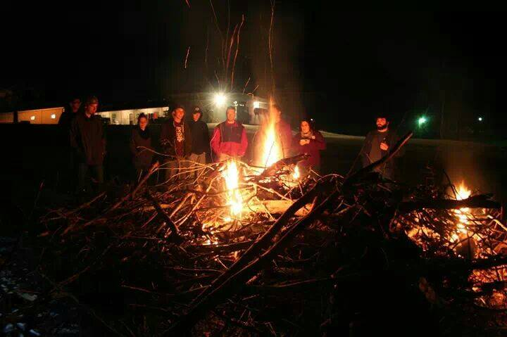 students around bonfire