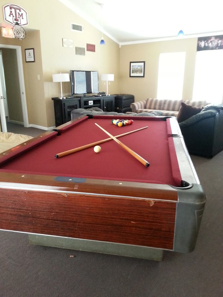 TV game maroon pool table couch