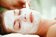 woman with white facial mask applied spa concept
