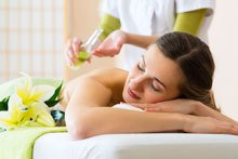 woman receiving oil massage spa concept