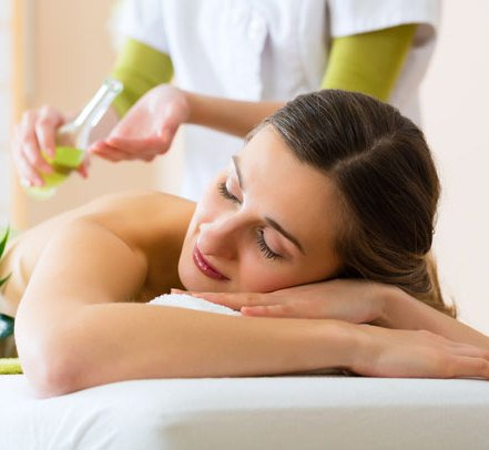 woman receiving oil massage at the spa