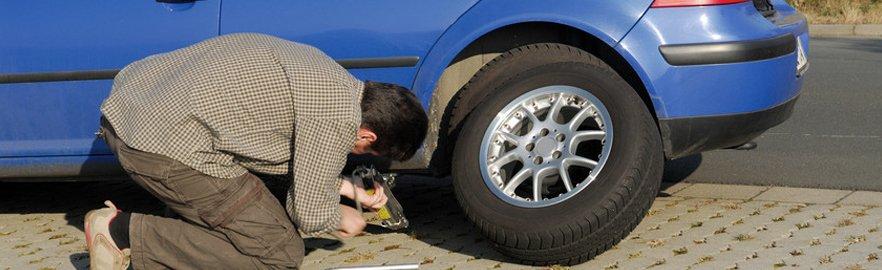 a man fixing a flat tyre