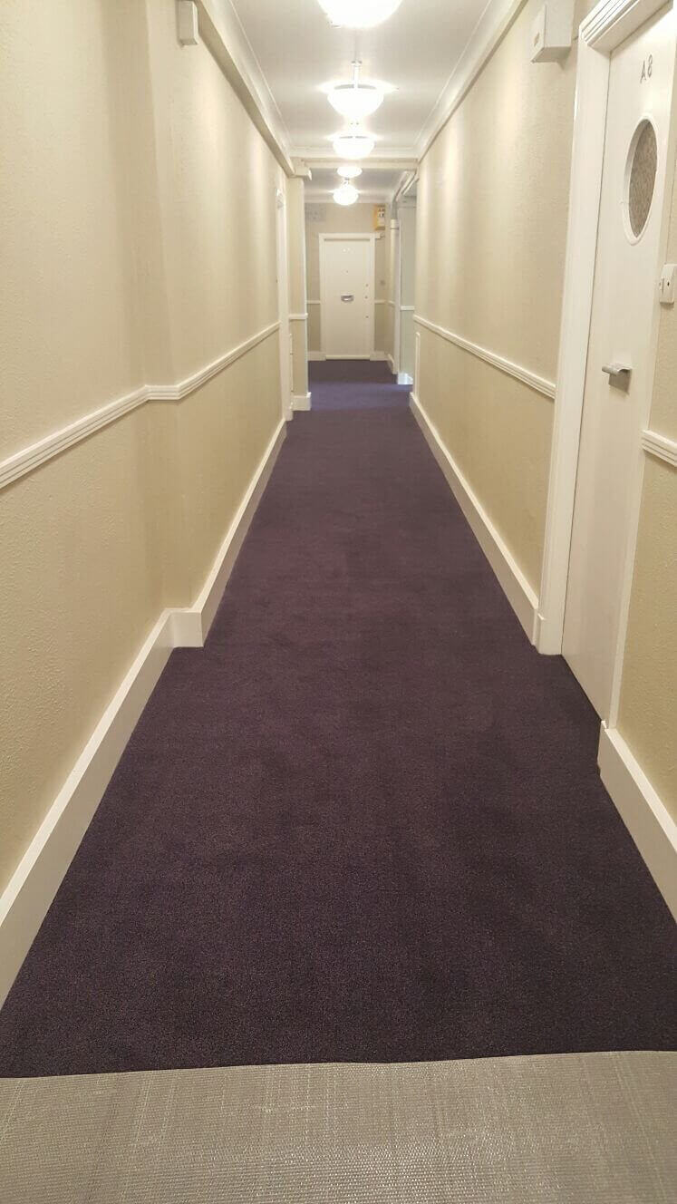 Dark red carpet in long corridor