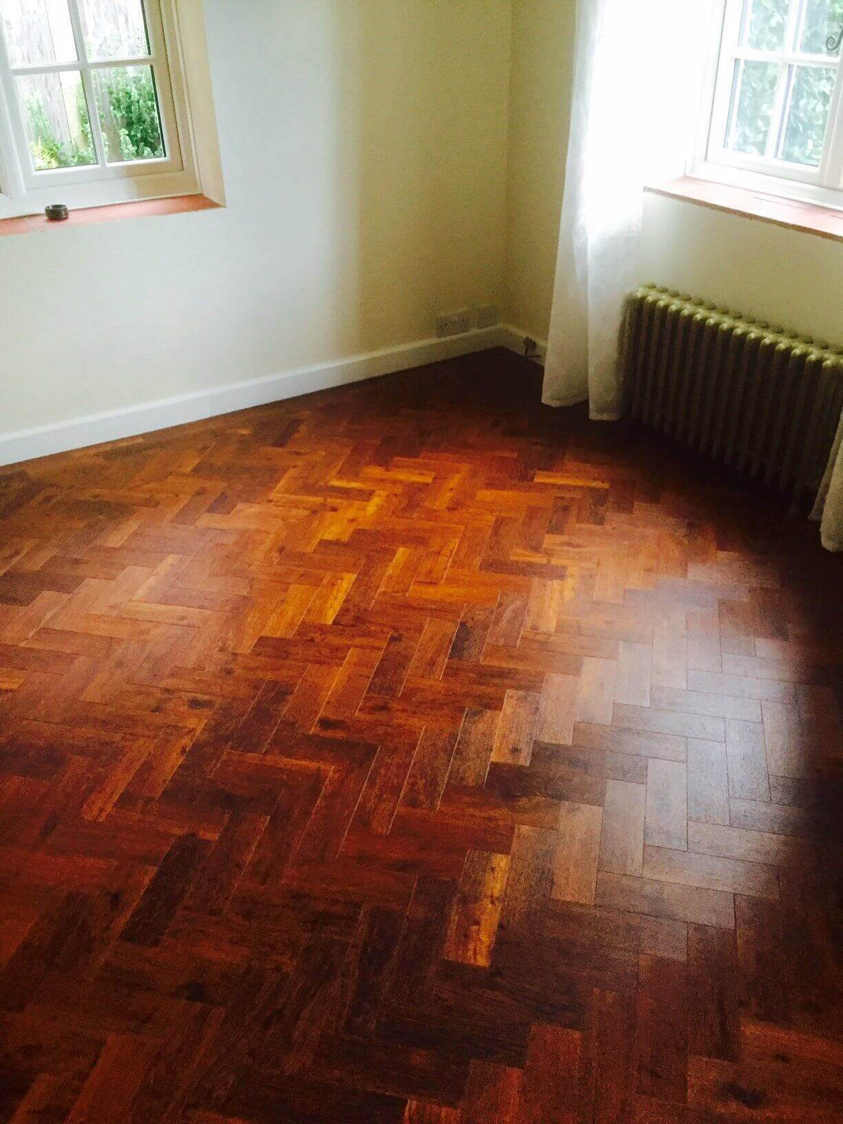 Dark stained parquet flooring