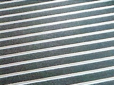 Close up of black and white striped carpet