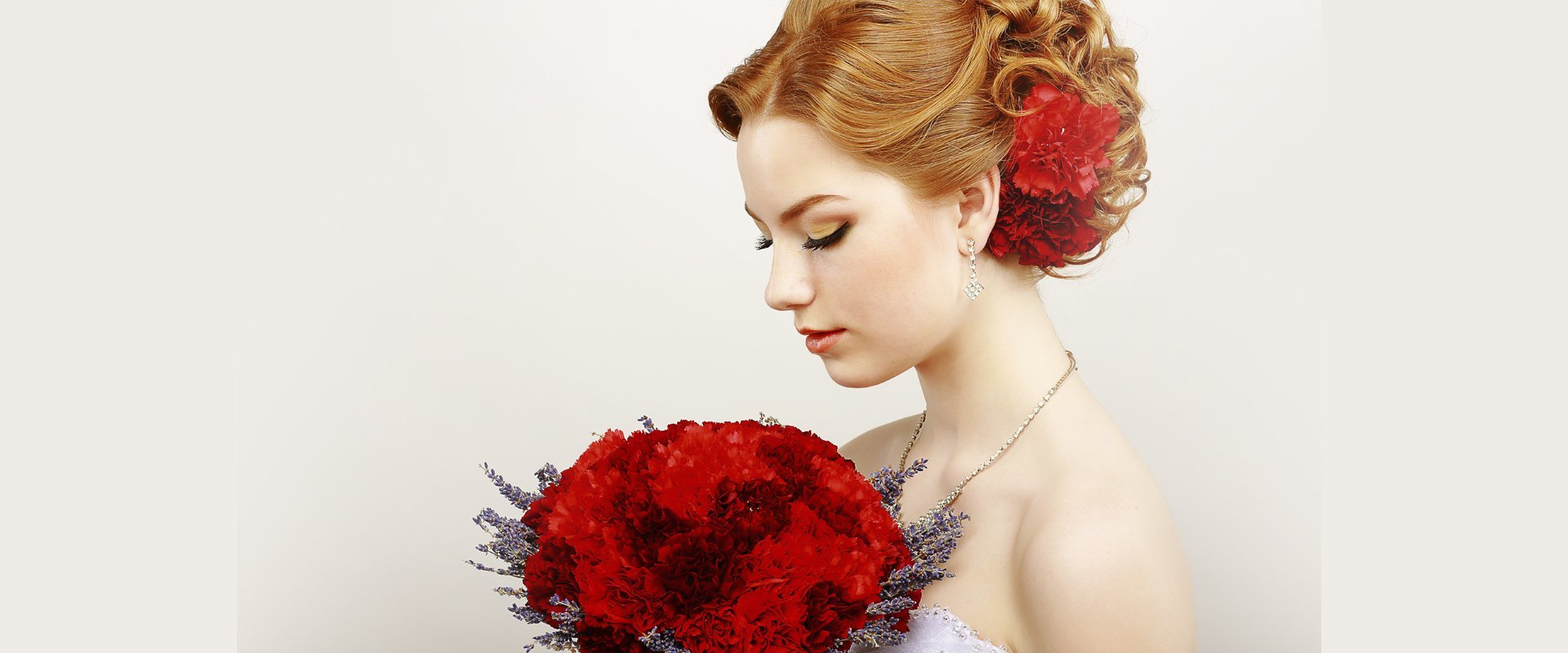 girl with red bouquet and hair accessories