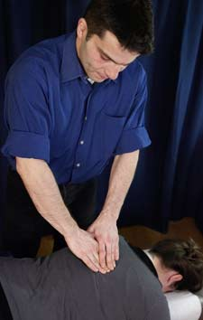 Dr. Michael Minond treating a Patient with NYC Thoracic Back Pain Treatments Located in the West Village of Manhattan New York City 10014