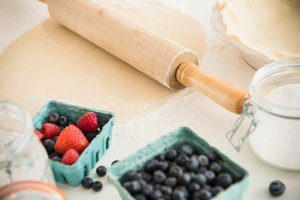 Dough being rolled out with strawberries and blueberries by Keeley's Kitchen in Surrey
