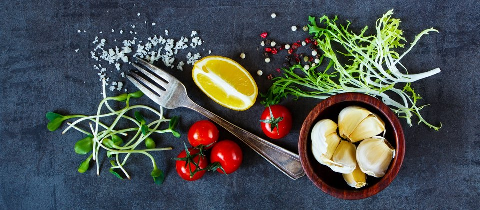 Selection of ingredients including lemon, salt, pepper, garlic and tomatoes by Keeley's Kitchen in Surrey