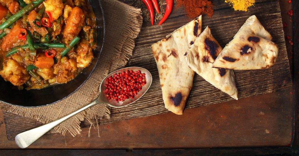 Curry with naan bread and spices by Keeley's Kitchen in Surrey