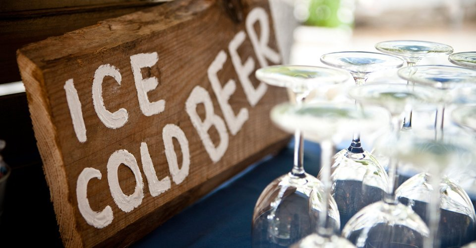 Rustic wooden sign for ice cold beer by Keeley's Kitchen in Surrey