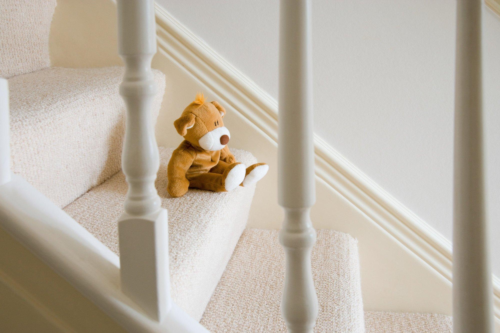 Teddy bear on stairs